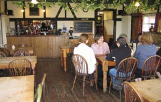 People enjoying food inside The Blacksmiths, Isle of Wight, local produce, let's buy local