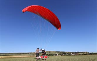 #15 - Take flight along the stunning coastline with a Paragliding experience