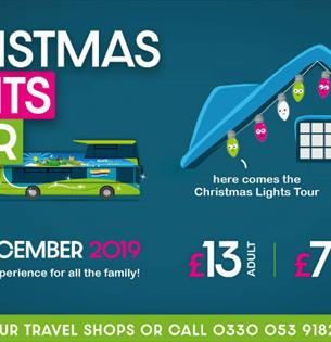 Southern vectis bus with roof of house displaying lights, title of event, date and contact details, What's On, Isle of Wight